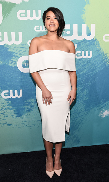 May 19: New look, new attitude! Gina Rodriguez showed off her new haircut in a cream Lavish Alice dress during the CW Upfront presentation in NYC. 