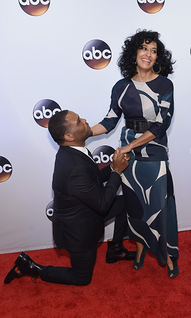 May 17: Say yes! Anthony Anderson couldn't help but fall to his knees after seeing <i>Blackish</i> co-star Tracee Ellis Ross in a sleek Marni outfit during the ABC Upfront presentation in NYC. 