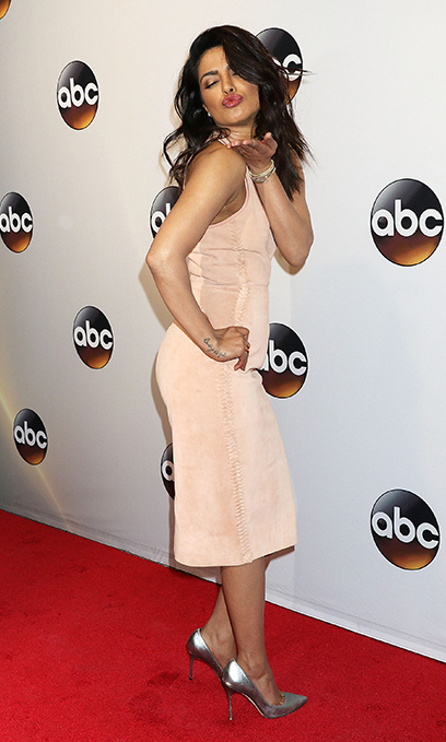 May 17: Stylish kisses! In one of her many outfits of the day, <i>Quantico</i> star Priyanka Chopra stunned in a suede Dion Lee dress during the ABC Upfront presentation. 