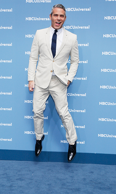 May 16: Jumping in style! Andy Cohen had some fun in a suit fit for spring during the NBC Universal Upfront presentation in NYC. 