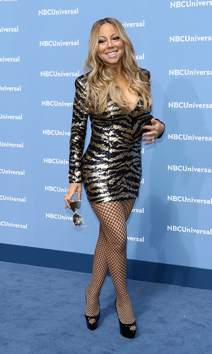 May 16: Sparkle dahling! Mariah Carey didn't let a slight slip out of her Christian Louboutins stop her from working the carpet in a zebra print mini dress during the NBC Upfront presentation in NYC. 