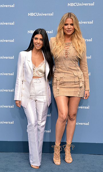 May 16: Stylish sisters! Khloe Kardashian rocked Balmain while her big sister Kourtney stunned in a Sergio Hudson power suit at the NBC Universal Upfront presentation in NYC. 