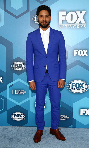 May 16: Dapper in blue! <i>Empire</i> star Jussie Smollett rocked a blue suit during the Fox Upfront presentation in NYC. 