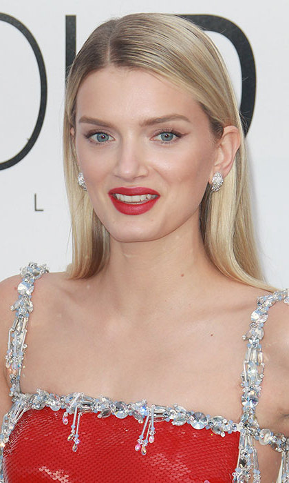 Lily Donaldson looked as radiant as ever, with her blonde hair worn down in a poker straight style, teamed with statement red lips for a showstopping finish.
