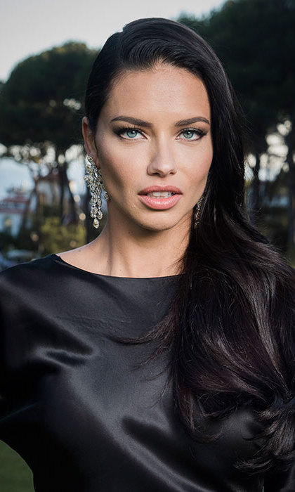 Adriana Lima was as sultry as ever with her black locks swept to the side in loose cascading curls. The model finished off her look with long dramatic eyelashes and a slick of pale pink lipstick.