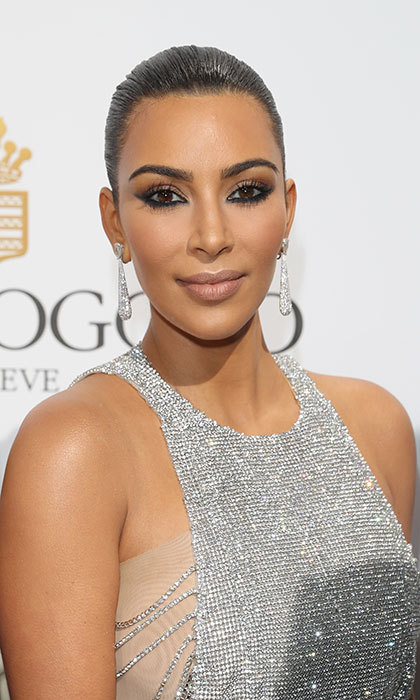 Not a hair was out of place as Kim Kardashian arrived for the De Grisogono party. The reality TV star wore her hair slicked back into a ballerina bun, adding a twist to a classic eyeliner look by focusing the make-up on her bottom lash line.