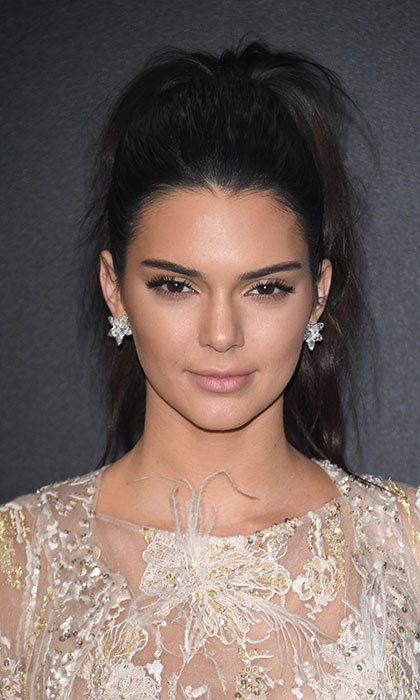 Also rocking the ponytail trend was Kendall Jenner at the Chopard party with this high, slightly undone style for ultimate glamour. The model combined dramatic eyelashes and pale pink lipstick for a laidback chic finish.