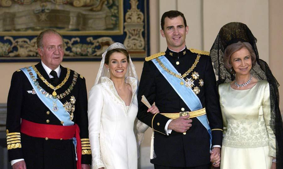 Smiles all round. The new husband and wife couldn't have been happier as they beamed broadly for their official wedding photos. The couple were joined by their family and guests for the pictures. In this photo they posed with Felipe's parents King Juan Carlos and Queen Sofia.