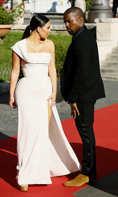 May 22: Mr. and Mrs. West are in the building! Kim Kardashian and Kanye West were a handsome pair during the <i>La Traviata</i> opera in Rome. 