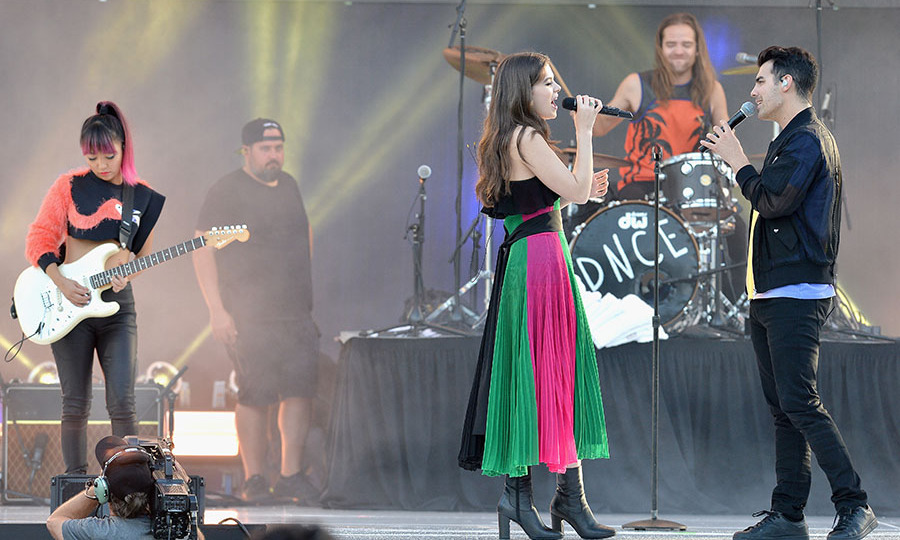 May 21: Music by the ocean! DNCE and Hailee Steinfeld performed their hit single <i>Rock Bottom</i> during the iHeartRadio Summer Pool Party at Fontainebleau Miami Beach.