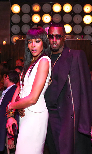 May 22: Birthday girl! Naomi Campbell posed for a picture with Sean 'P. Diddy' Combs inside of her birthday celebration at PHD Rooftop Lounge at Dream Downtown in NYC. 