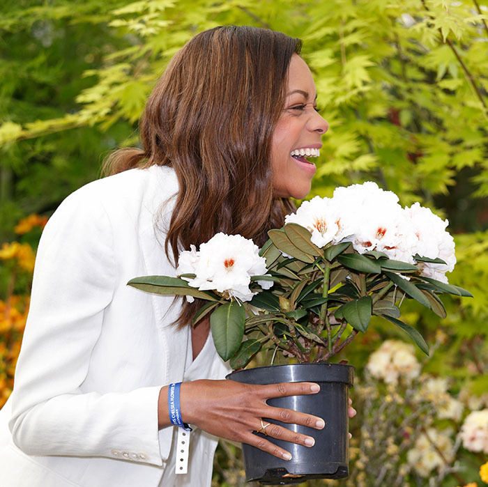 Not just for royals! Naomie Harris stopped to smell the flowers during her visit to the Chelsea Flower Show. 