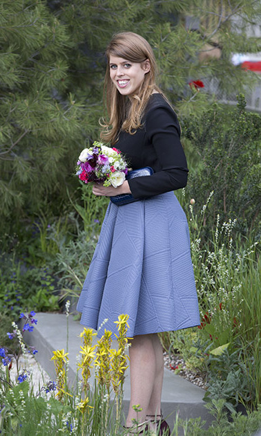 Princess Beatrice posed with her new floral arrangement during her visit to the Chelsea Flower Show.
