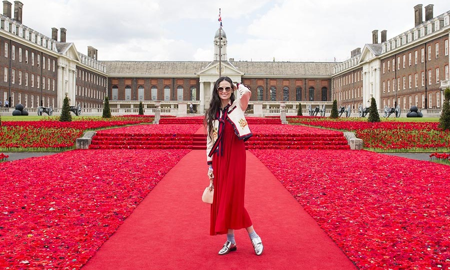 Blending in! Demi Moore took some time out to pose for a picture during her visit to the Chelsea Flower Show.