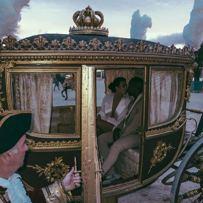 In true princess fashion, Kim shared a sweet moment with Kanye inside of the carriage on her way to living happily ever after. 