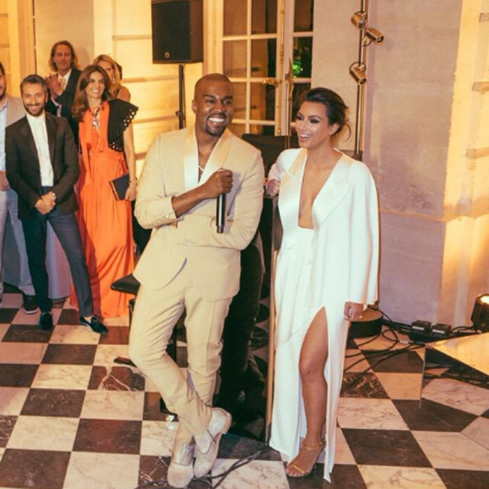 Unafraid to grab the mic, Kanye gave a speech on behalf of the couple in front of their guests during their rehearsal dinner/party. 