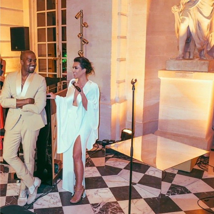 All of the lights weren't on Kanye as Kim grabbed the mic and gave her own speech during the lavish event. 