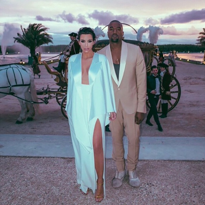 In true KimYe fashion, the duo showed up in a car but left in a horse drawn carriage. 