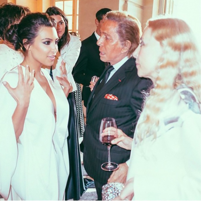Kim shared a moment with some of her high profile guests including Valentino. 