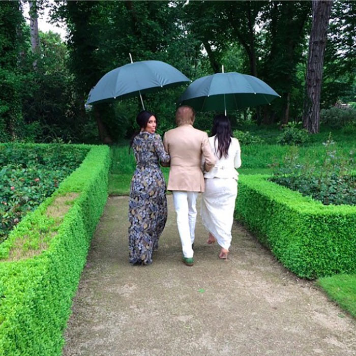 Kim had a playful moment while strolling through the garden with her sister Kourtney. 