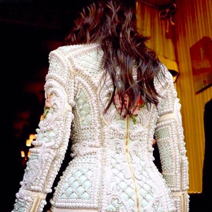 "Kim captioned the photo of her dress ""diamonds and pearls."" 