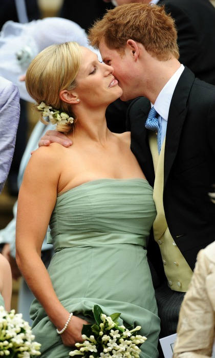 Prince Harry gave his cousin Zara Phillips a kiss on the cheek during her brother Peter Phillips' wedding, where she acted as a bridesmaid. 