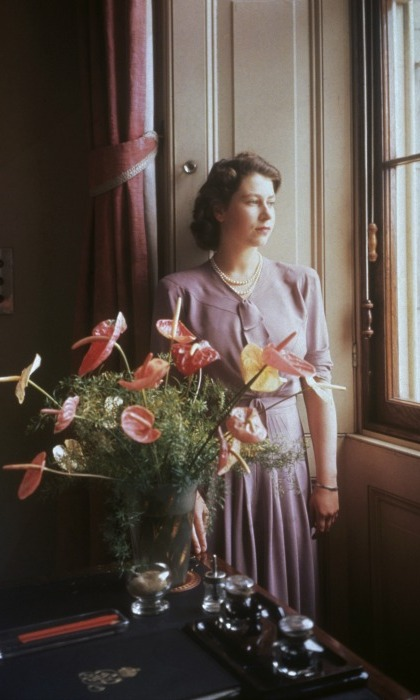 A future queen and her flowers! A young Queen Elizabeth was picture perfect as she gazed out of a window during a photo session. 