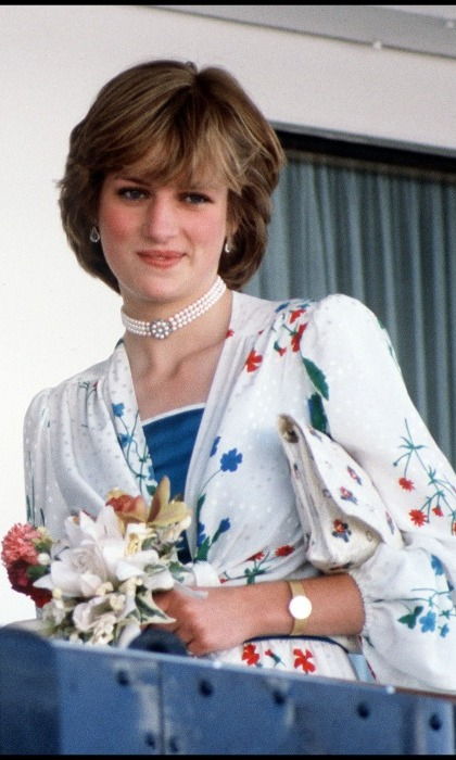 Princess Diana held on to a small bouquet of flowers before embarking on her honeymoon. 