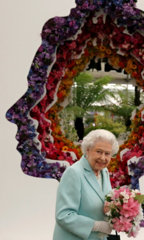 During her trip to the Chelsea Flower Show, Queen Elizabeth, who was presented with a few lily of the valleys, showed off her sense of humor during her visit. 