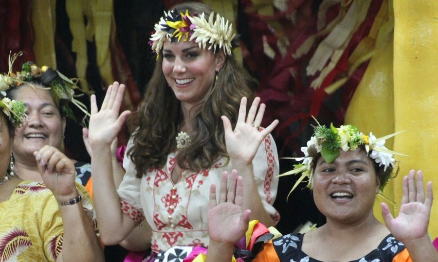 Floral style watch! Kate Middleton added traditional crown of blossoms to her look while participating in a traditional dance in Funafuti on Tuvalu.