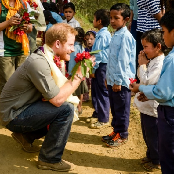 Prince Harry was presented with a nice floral arrangement as he offered a namaste greeting to children in Nepal. 