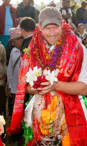 Bring on the flowers! Prince Harry was all smiles (and flowers) during a fun moment in Nepal. 
