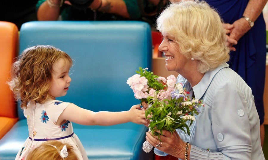 Duchess Camilla received a sweet bouquet from a two-year-old girl during a story time session in New Zealand.
