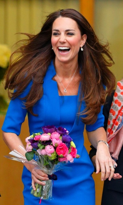 Kate Middleton grinned as she walked with her flowers at the ICAP Art Room opening. 