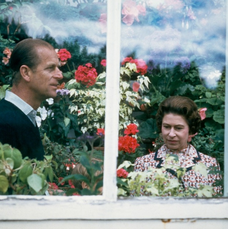 A room of flowers for two! In this vintage shot, Queen Elizabeth and Prince Phillip spend some time in a greenhouse during their visit to Scotland. 