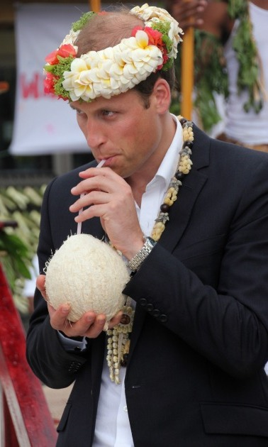 Flowers on your hair! Prince William was all out and festive during his visit to Funafuti in Tuvalu, where he drank milk from a coconut that grew on a tree planted by his grandmother. 