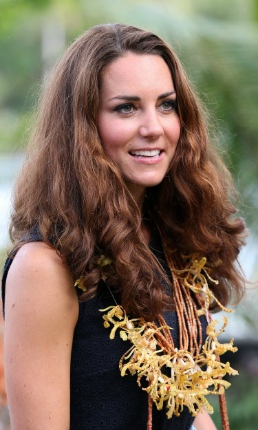 Flowers and waves! Kate's accessory perfectly complimented her wavy hair during her visit to the Solomon Islands.  