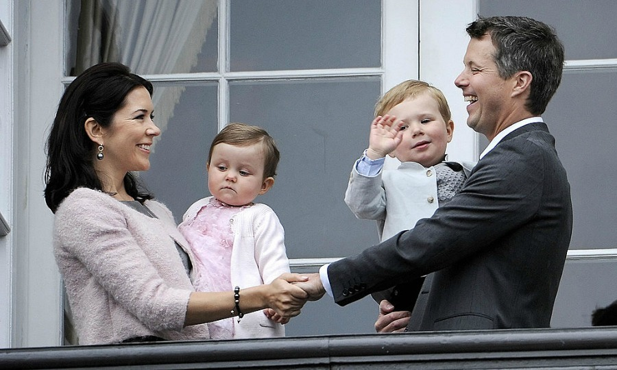 They're in it together. The royals held hands from the balcony of Amalienborg Palace in Copenhagen, while celebrating Frederik's 40th birthday in 2008 with their children Princess Isabella and Prince Christian.
