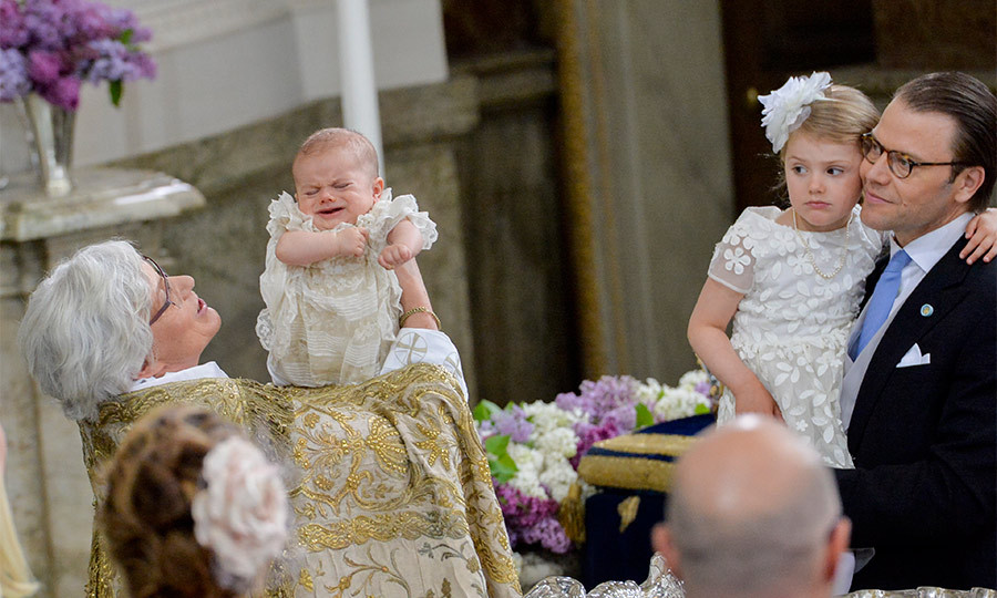 As sister Princess Estelle and her dad Prince Daniel looked on, Oscar was baptized with water that came from a special spring on the island of Öland, over a silver font that dates from the early 18th century.