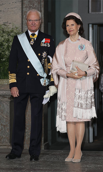 King Carl XVI Gustaf and Queen Silvia looked on proudly as they made their exit from the royal palace's chapel.