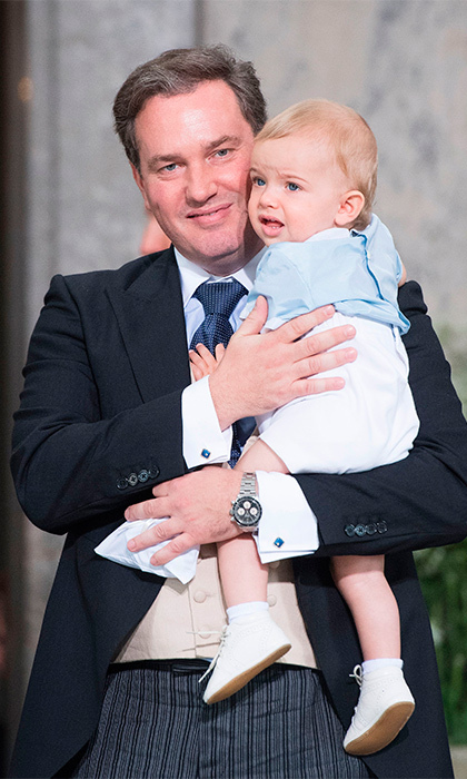 Madeleine's husband cuddled up to Prince Nicolas, who was recently christened in October, as they left the service.