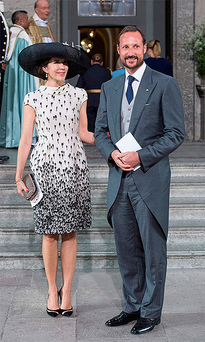 Crown Princess Mary of Denmark, pictured here with good friend Crown Prince Haakon of Norway, looked chic in a cream and blue patterned dress and a matching hat. 