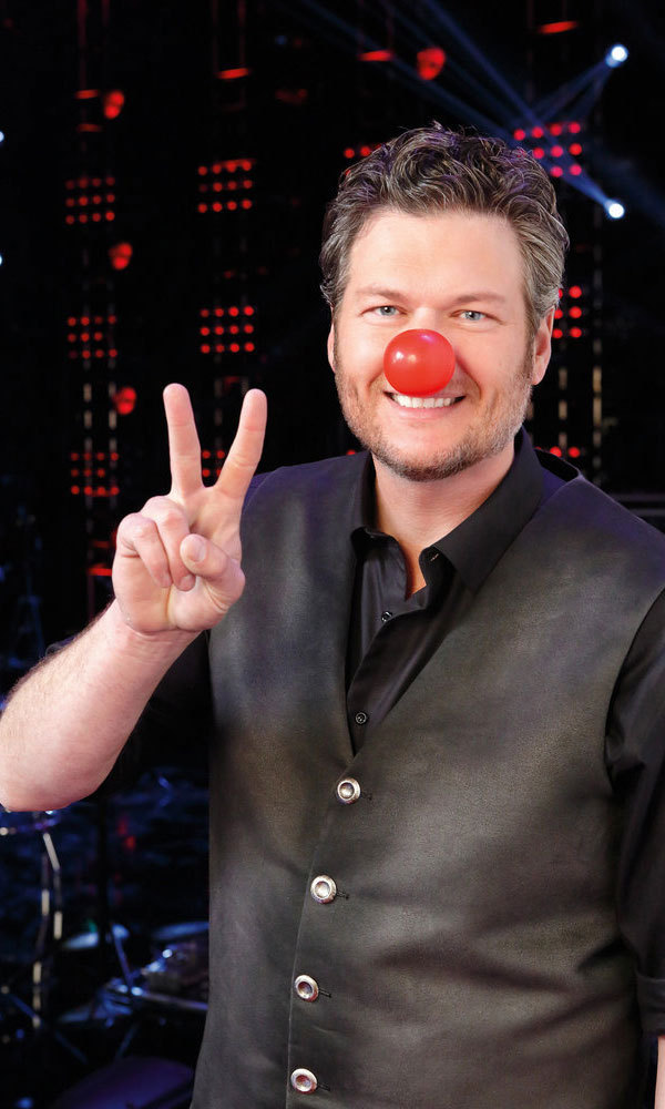 Peace, love and red noses. Blake Shelton joined in on the fundraising by performing his song <i>My Savior's Shadow</i> during the TV special.