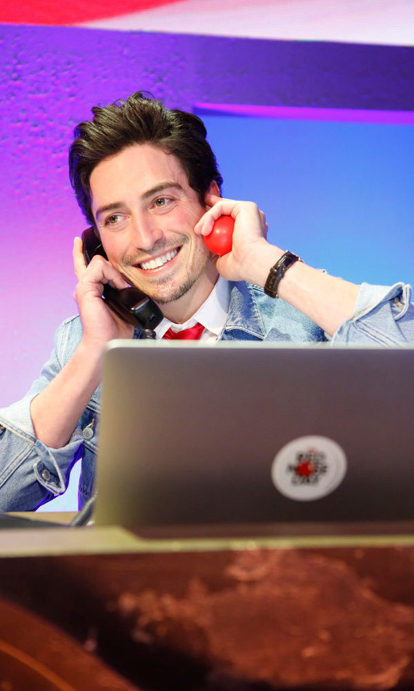 Two phones are better than one! <i>Superstore</i> actor Ben Feldman manned the phones raising money for the NBC special.