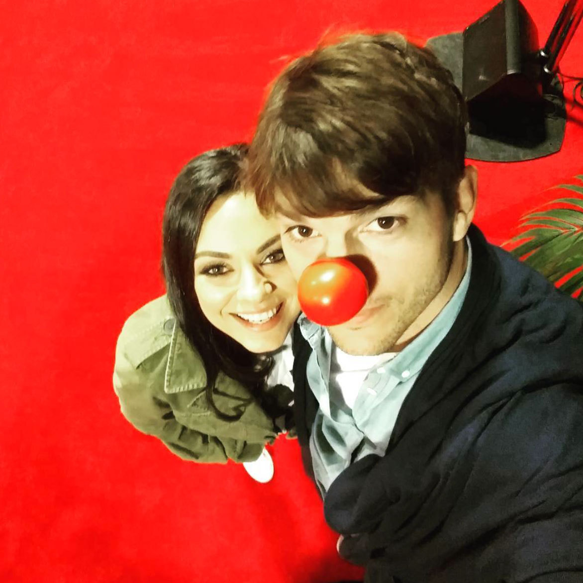 Hello from below! Ashton Kutcher snapped a photo with wife Mila Kunis at NBC's live Red Nose Day special, where they along with 70 other Hollywood stars came together to raise money for children in need.