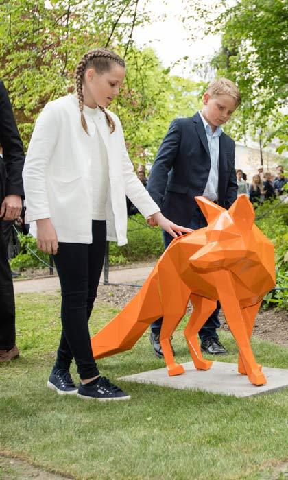 Princess Ingrid Alexandra and Prince Sverre Magnus of Norway were captivated by a orange fox sculpture as they walked round the Princess Ingrid Alexandra Sculpture Park.