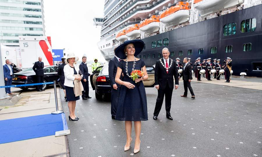 Queen Maxima of The Netherlands looked beautiful in a dark blue lace dress and a wide-brimmed blue hat, as she baptized the cruise ship MS Koningsdam.
