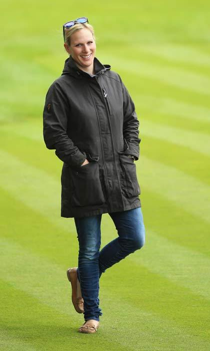 The mom-of-one kept it casual for the golf tournament, dressing down in jeans, a green coat and beige flats.