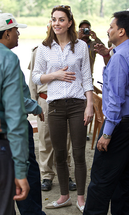 The royal mom was ready for her trip to the Kaziranga National Park wearing brown biker trousers by Zara and a polka dot blouse from RM Williams.