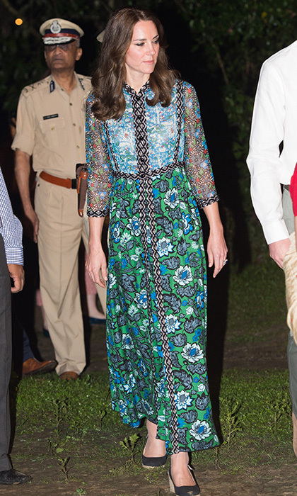 Prince George's mom made a colorful statement in mixed prints, stepping out at the Kaziranga National Park wearing a floral and animal motif Anna Sui silk-chiffon and twill dress.